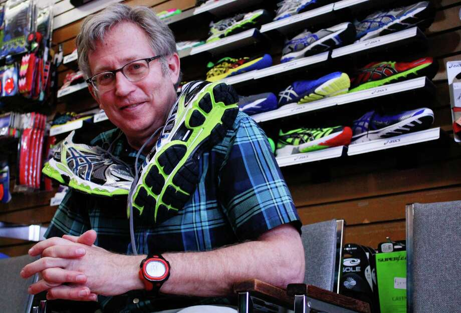 Andy Stewart's Finish Line Sports store in Sugar Land holds five races each year, with proceeds going to charity. Photo: Hendrick C. Rosemond / © 2014 Houston Chronicle