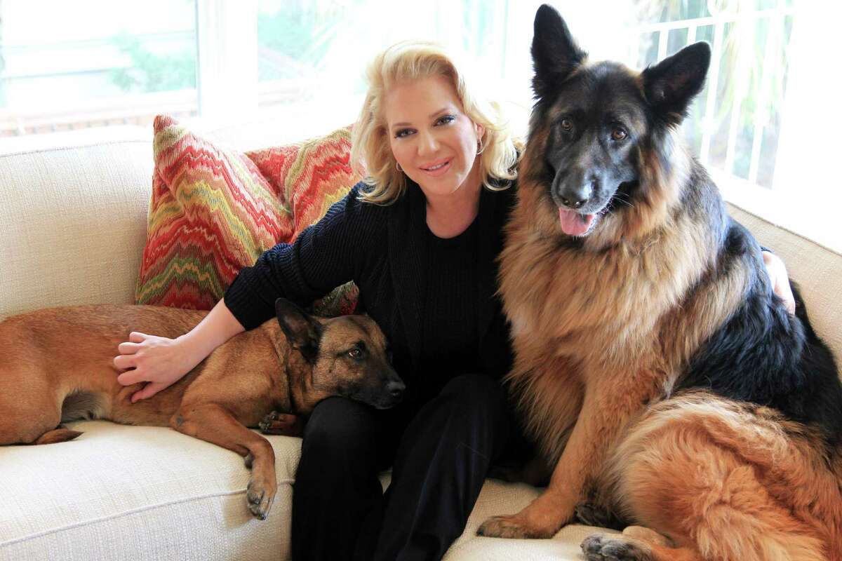 Kristi Schiller, with guard dogs Daisy and Johnny Cash, is the founder and chair of K9s4Cops and an offshoot, K9s4Kids, which works to beef up security at school campuses.