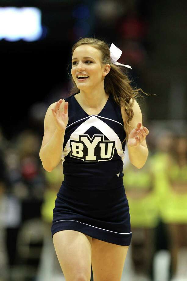 MILWAUKEE, WI - MARCH 20: A Brigham Young Cougars cheerleader performs during the second round game of the NCAA Basketball Tournament against the Oregon Ducks at BMO Harris Bradley Center on March 20, 2014 in Milwaukee, Wisconsin. Photo: Mike McGinnis, Getty Images / 2014 Getty Images