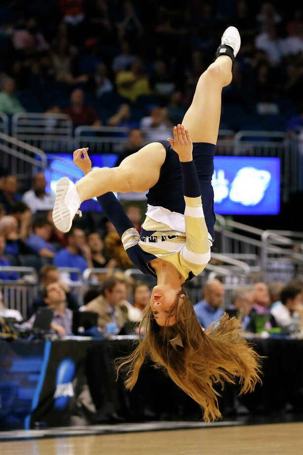 ORLANDO, FL - MARCH 20:  A Pittsburgh Panthers cheerleader flips during a break in the game against the Colorado Buffaloes in the second round of the 2014 NCAA Men's Basketball Tournament at Amway Center on March 20, 2014 in Orlando, Florida. Photo: Kevin C. Cox, Getty Images / 2014 Getty Images