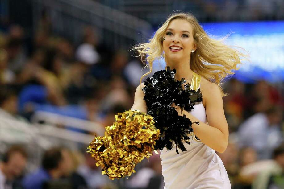 ORLANDO, FL - MARCH 20:  A Colorado Buffaloes cheerleader performs in the first half while the Buffaloes take on the Pittsburgh Panthers during the second round of the 2014 NCAA Men's Basketball Tournament at Amway Center on March 20, 2014 in Orlando, Florida. Photo: Kevin C. Cox, Getty Images / 2014 Getty Images