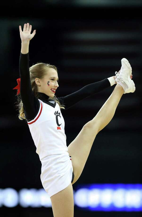 SPOKANE, WA - MARCH 20:  A Cincinnati Bearcats cheerleader in action during their game against the Harvard Crimson in the second round of the 2014 NCAA Men's Basketball Tournament at Spokane Veterans Memorial Arena on March 20, 2014 in Spokane, Washington. Photo: Stephen Dunn, Getty Images / 2014 Getty Images