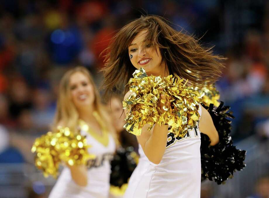 ORLANDO, FL - MARCH 20:  A Colorado Buffaloes cheerleader performs in the second half while taking on the Pittsburgh Panthers during the second round of the 2014 NCAA Men's Basketball Tournament at Amway Center on March 20, 2014 in Orlando, Florida. Photo: Kevin C. Cox, Getty Images / 2014 Getty Images
