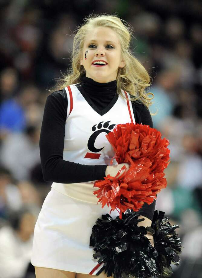 SPOKANE, WA - MARCH 20:  A Cincinnati Bearcats cheerleader in action during their game against the Harvard Crimson in the second round of the 2014 NCAA Men's Basketball Tournament at Spokane Veterans Memorial Arena on March 20, 2014 in Spokane, Washington. Photo: Steve Dykes, Getty Images / 2014 Getty Images