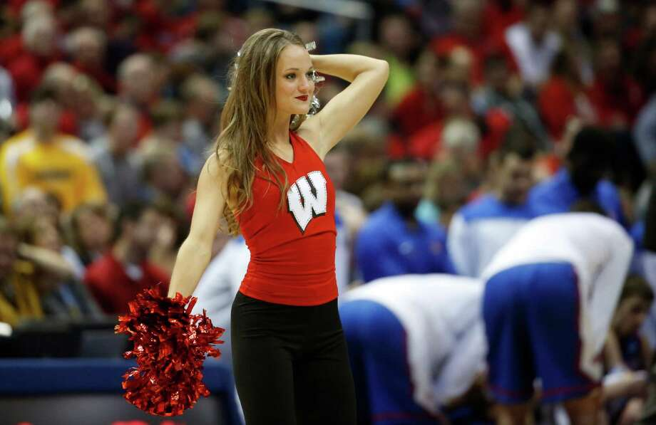A Wisconsin cheerleader performs during the second half of a second-round game between the Wisconsin and the American in the NCAA college basketball tournament Thursday, March 20, 2014, in Milwaukee. (AP Photo/Jeffrey Phelps) Photo: Jeffrey Phelps, Associated Press / FR59249 AP