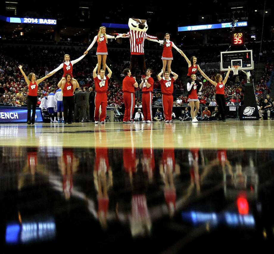 MILWAUKEE, WI - MARCH 20:  The Wisconsin Badgers mascot, Bucky Badger, performs with cheerleaders during the second round game of NCAA Basketball Tournament against the American University Eagles at BMO Harris Bradley Center on March 20, 2014 in Milwaukee, Wisconsin. Photo: Mike McGinnis, Getty Images / 2014 Getty Images