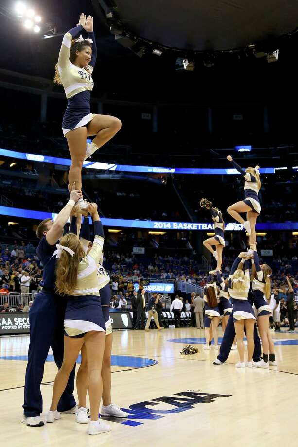 ORLANDO, FL - MARCH 20:  Pittsburgh Panthers cheerleaders perform during a break in the game against the Colorado Buffaloes in the second round of the 2014 NCAA Men's Basketball Tournament at Amway Center on March 20, 2014 in Orlando, Florida. Photo: Mike Ehrmann, Getty Images / 2014 Getty Images