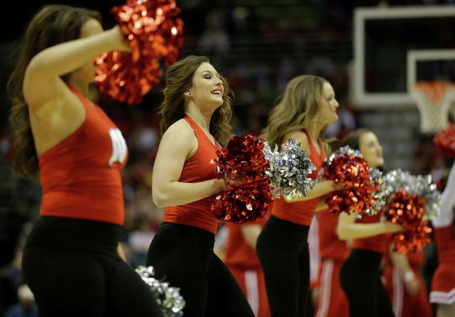 Wisconsin cheerleaders perform during the first half of a second-round game in the NCAA college basketball tournament Thursday, March 20, 2014, in Milwaukee. (AP Photo/Morry Gash) Photo: Morry Gash, Associated Press / AP