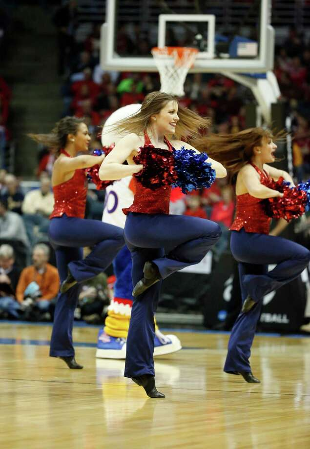American cheerleaders perform during the first half of a second-round game in the NCAA college basketball tournament Thursday, March 20, 2014, in Milwaukee. (AP Photo/Jeffrey Phelps) Photo: Jeffrey Phelps, Associated Press / FR59249 AP