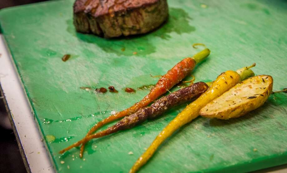 Roasted vegetables and the beef tenderloin at Gusto in San Carlos. Photo: John Storey, Special To The Chronicle