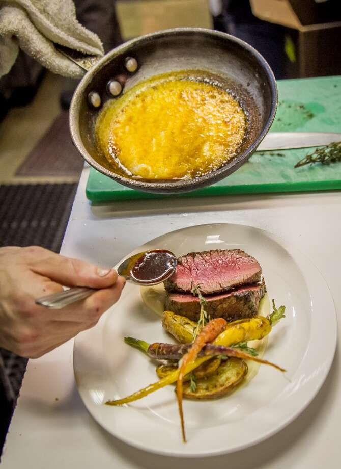 The Beef Tenderloin being sauced at Gusto in San Carlos. Photo: John Storey, Special To The Chronicle