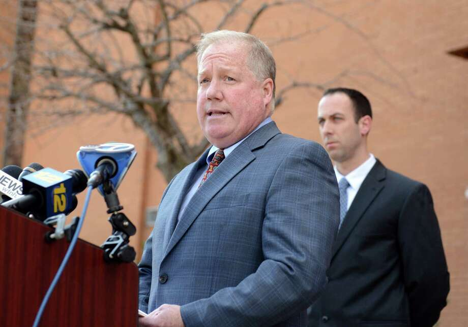 Attorney Michael Boynton, spokesman for the family of Kristjan Ndoj, the 15 year-old Shelton High student who was shot in the head and the leg Saturday evening, reads a statement to the media Thursday, Mar. 20, 2014, outside Shelton High School in Shelton, Conn. Ndoj died Thursday morning at Bridgeport Hospital. Photo: Autumn Driscoll / Connecticut Post