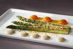 Asparagus in Smoked Butter With Kumquat Confiture & Hazelnut Cream (Jessica Largey, Manresa) as seen in San Francisco, California on Wednesday March 19, 2014. Food styled by Calvin Rouse, III.