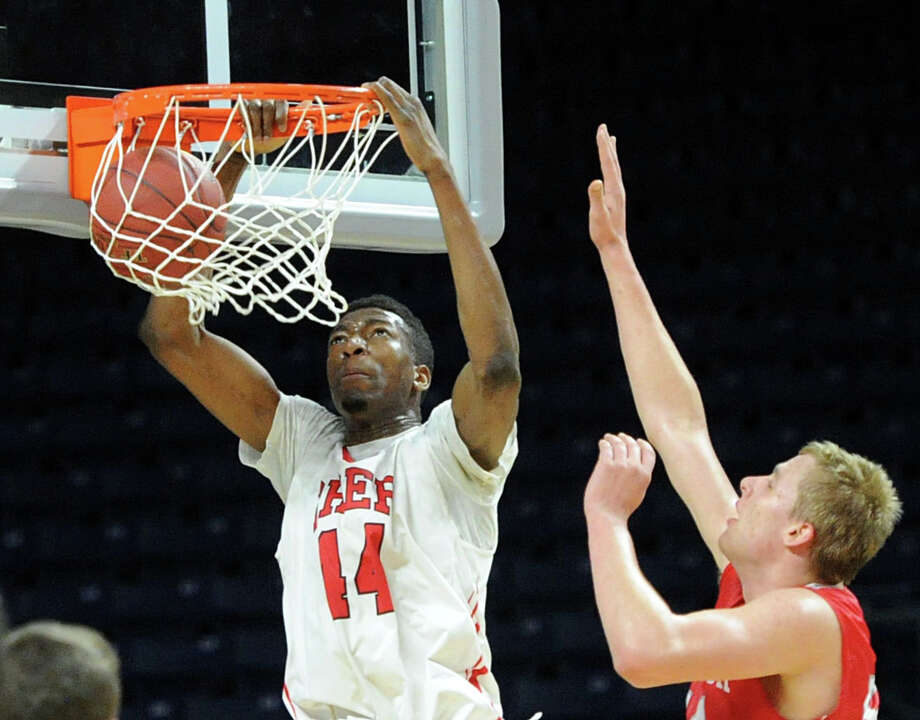 The Class LL boys basketball semi-final game between Fairfield Prep and Greenwich High School at the Webster Bank Arena in Bridgeport, Conn., Wednesday, March 19, 2014. Fairfield Prep defeated Greenwich by the score of 59-41 to advance to the final. Photo: Bob Luckey / Greenwich Time