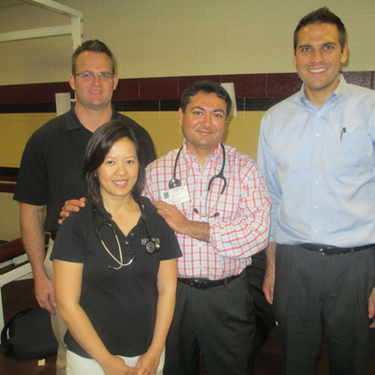 Assisting in providing physicals to students last year were, from left, Drs. Shaun Weaver, Doan Do, Tejas Mehta and Wasyl Fedoriw.