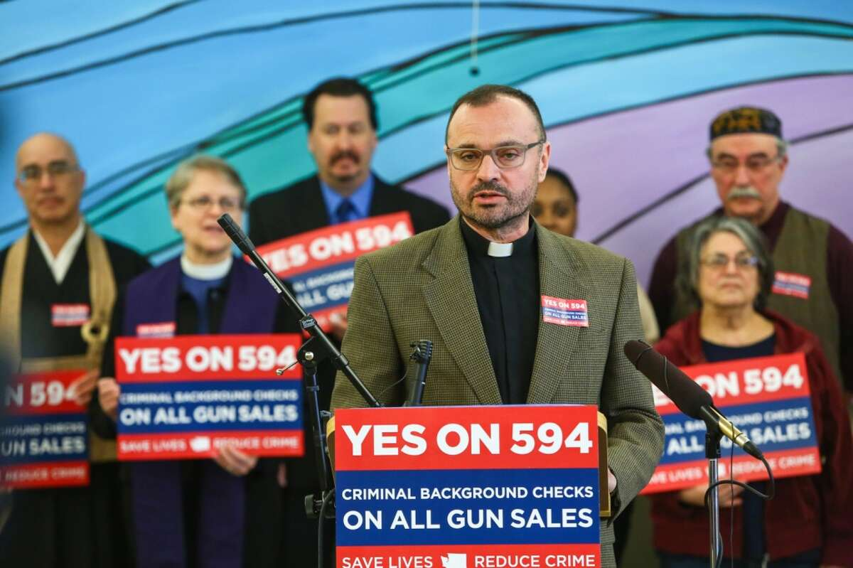 The Rev. Sandy Brown speaks as the campaign for Initiative 594 is officially launched at First United Methodist Church in Seattle. He is now lead pastor at Edmond United Methodist Church, and repudiating