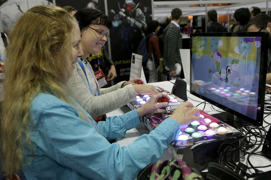 "Linda Law (left) and Wendy Despain play ""Tenya Wenya Teens"" at the Game Developers Conference in San Francisco. Photo: Jeff Chiu, Associated Press"