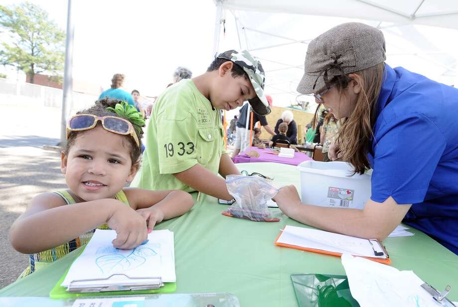 Sha'lynn and Cadin Jones participate in crafts at the Art in the Park event at Stark Park in Orange during the 2013 Orange County River Festival. Photo taken: Randy Edwards/The Enterprise
