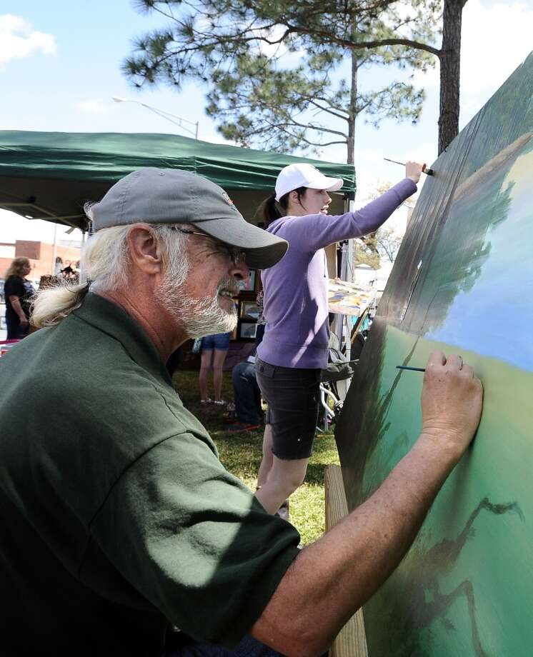 Father and daughter team; Tom Windham and Melissa Neill work on their collaborative painting at the Art in the Park event at Stark Park in Orange during the 2013 Orange County River Festival. Photo taken: Randy Edwards/The Enterprise