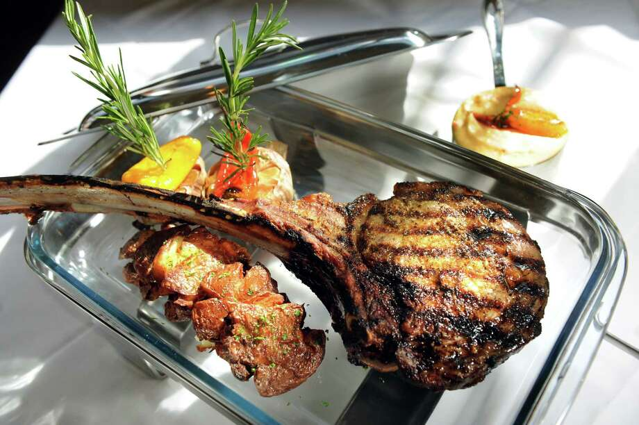 Angelo's 677 Prime677 BroadwayAlbany518-427-7463Visit Web sitePrime 32-ounce tomahawk ribeye for two with roasted red bliss potatoes, lobster mashed potatoes, roasted garlic and 677 steak seasoning Thursday, March 13, 2014, at 677 Prime in Albany, N.Y. (Cindy Schultz / Times Union) Photo: Cindy Schultz / 00026109A