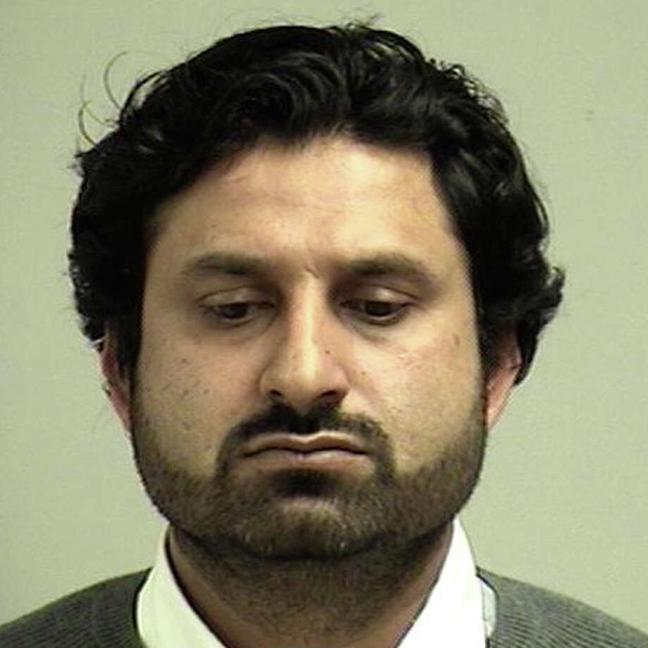 Muhammad Jatoi, 37, of Port Jefferson, N.Y., was charged with second-degree breach of peace and unlawful restraint when police said he forcibly tried to kiss a woman against her will outside a local restaurant last October. Photo: Westport Police Department / Westport News