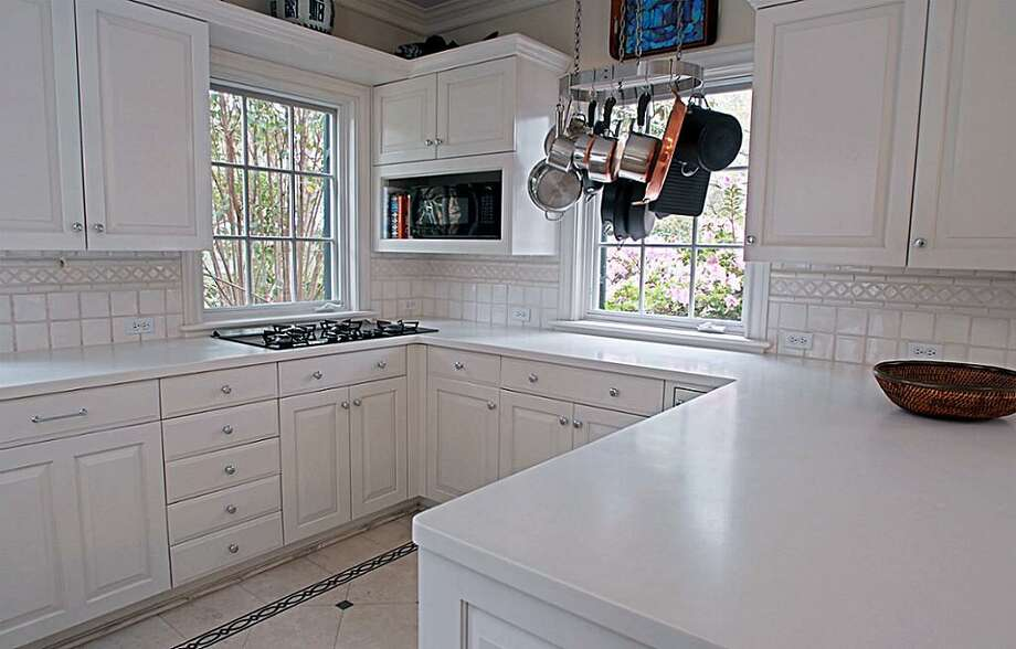 This charming plantation-style home, located at 1936 Rice Blvd.  near Rice University, is on the Houston real estate market for the  first time in 32 years. List Price: $3,150,000. For more information on  viewing or purchasing this home, contact realtor Edith Archer. Photo: Houston Association Of Realtors (HAR.com)