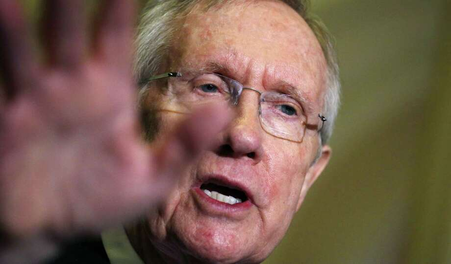 "Senate Majority Leader Harry Reid  seems to have a vendetta against billionaire brothers Charles Koch  and David Koch. He referred to the brothers as ""about as un-American as anyone that I can imagine"" because they have donated millions to fund anti-Obamacare ads and other efforts opposing Democrats. Photo: Charles Dharapak, Associated Press / AP"