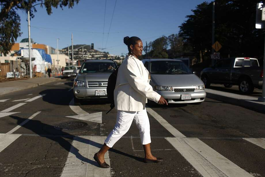 City College of San Francisco student Latonia Williams walks the rest of the way to work from her bus stop in January. Photo: Lea Suzuki, The Chronicle