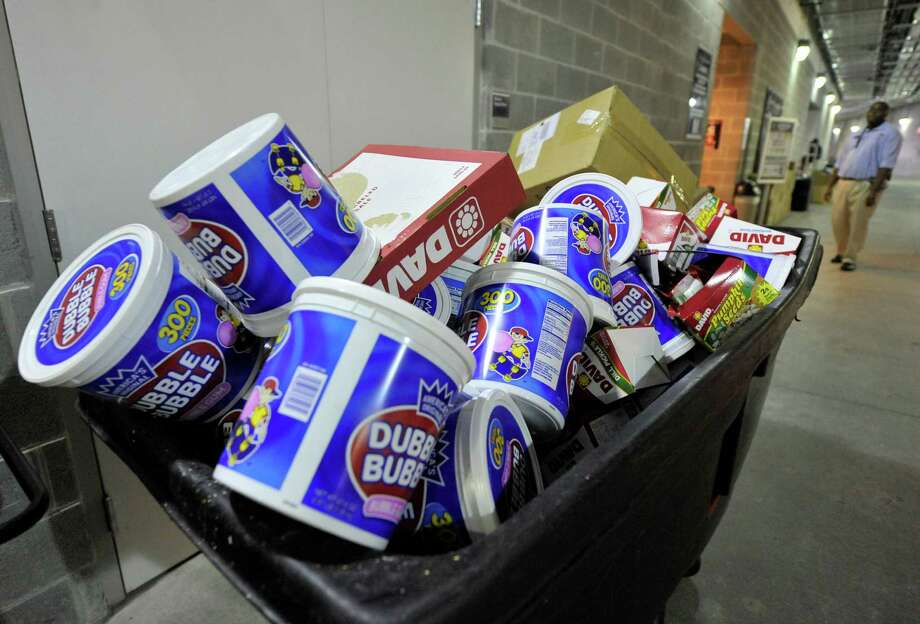 FILE - In this Sunday Oct. 24, 2010, file photo, a garbage bin sits full of bubble gum, at Yankee Stadium, in New York. U.S. gum sales tumbled 11 percent over the past four years. (AP Photo/Kathy Kmonicek, File) ORG XMIT: NYBZ150 Photo: Kathy Kmonicek / FR170189 AP