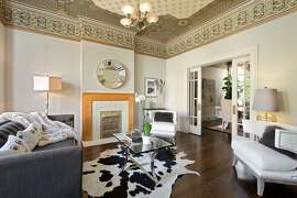 The Victorian features a double parlor with hand-printed Bradbury & Bradbury ceilings.
