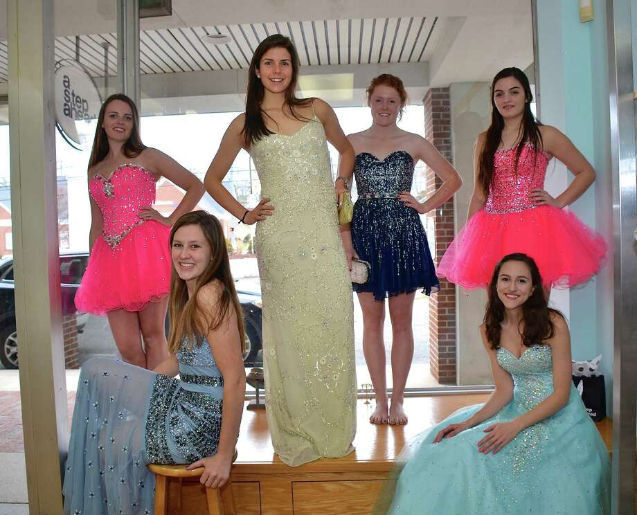 New Canaan High School seniors spent Monday afternoon, March 17, at A Step Ahead in Stamford, choosing dresses for the NCHS Prom Fashion Show, to be held on March 29, 2014.  Seated: Hayley Graham and Elena Kyriakos. In back: Tatum O'Mahony, Mary Campbell, Emily Wood, and Brianna Soro. Photo: Jeanna Petersen Shepard, Freelance Photo / New Canaan News freelance