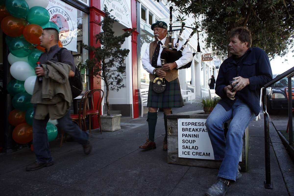 Lynne Miller plays the bagpipes outside of Farley's Coffee in Potrero Hill where people gathered to celebrate its 25th anniversary on St. Patrick's Day, Monday March 17, 2014, in San Francisco, Calif.