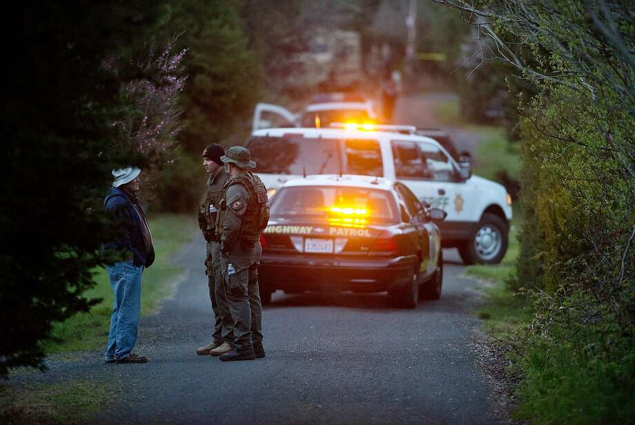 "Resident Elbert ""Bud"" Burdick speaks with two Mendocino County SWAT team members as he tries to gain access to his home near the slaying. Photo: Alvin Jornada, Associated Press"