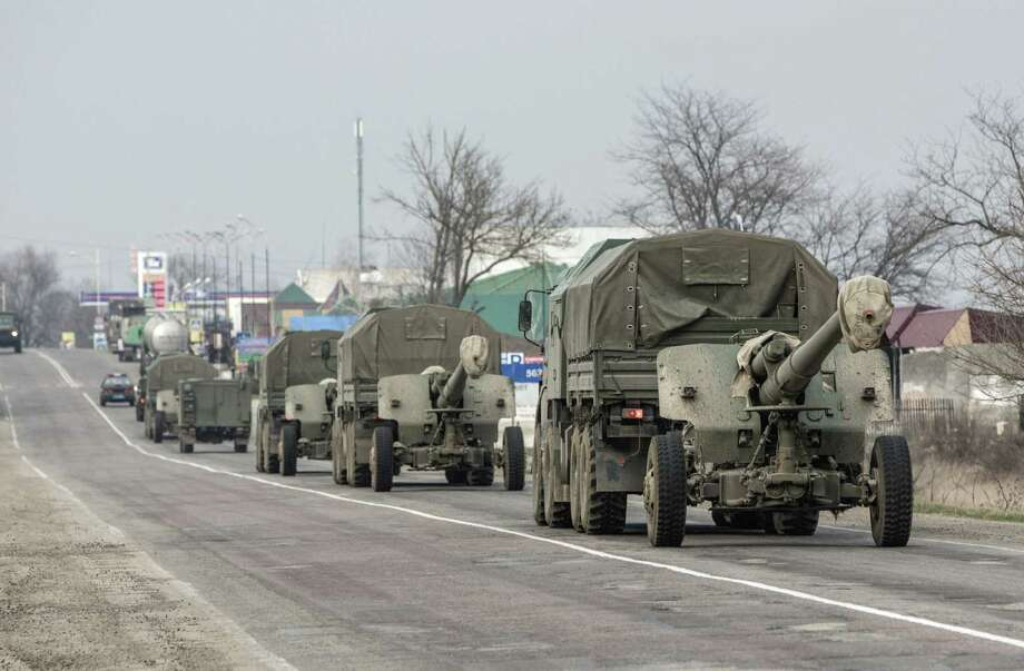 "A reader questions whether those ""yapping"" at President Barack Obama on the Ukraine crisis have answers of their own. A convoy of trucks towing artillery  moves at a security checkpoint near Chongar, Crimea, Ukraine. Photo: Andrei Udovichenko / Associated Press / AP"