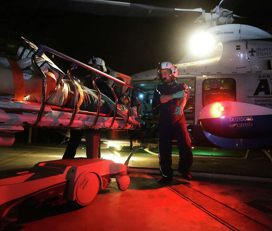 Air Life flight medic Mike Boulding (right) and flight nurse Shawn Russell prepare to take a patient from Nixon to University  Hospital. Air Life has seen an increase in calls  in the Eagle Ford Shale. Photo: Bob Owen / San Antonio Express-News / © 2012 San Antonio Express-News