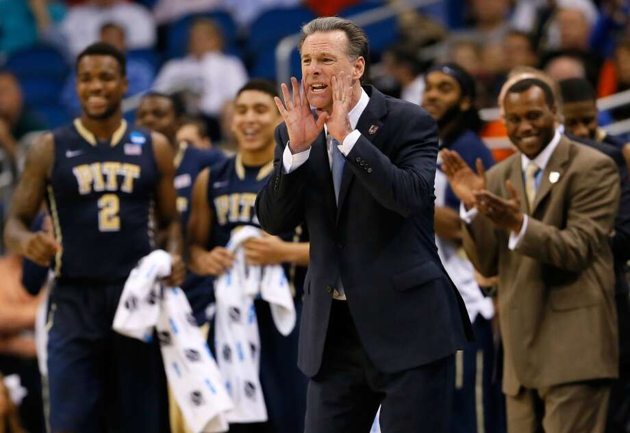 Jamie Dixon yells instructions to his team during the second half. Photo: Kevin C. Cox, Getty Images