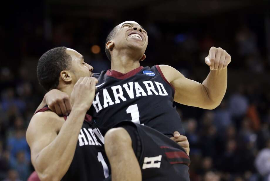 Second round March 20: No 12 Harvard 61, No. 5 Cincinnati 57 Harvard's Siyani Chambers, right, leaps into the arms of teammate Brandyn Curry after the upset win. Photo: Elaine Thompson, Associated Press