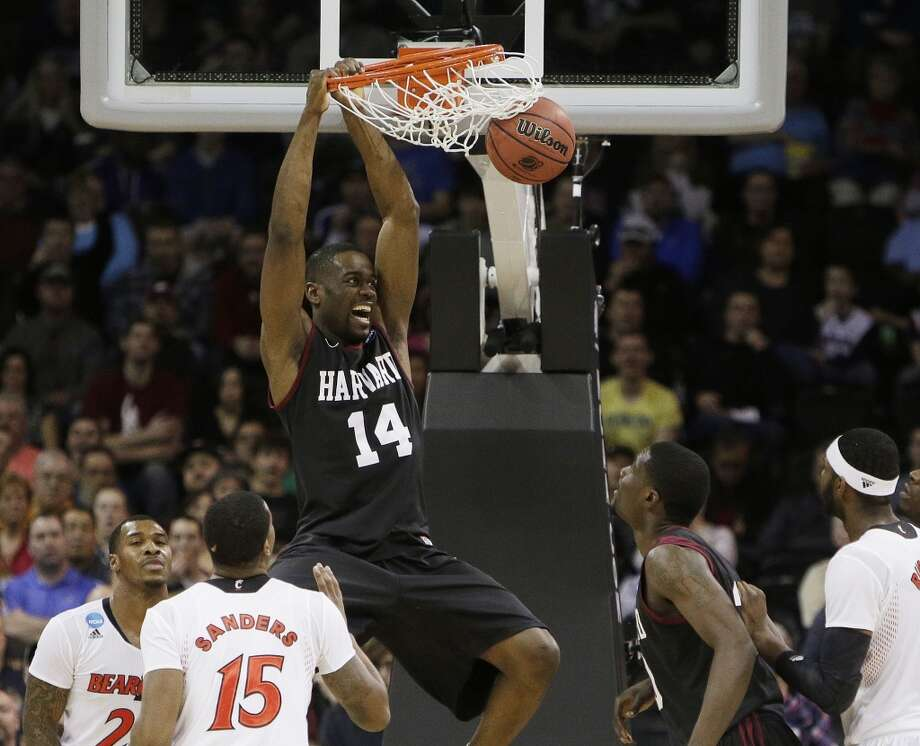 Harvard's Steve Moundou-Missi dunks against Cincinnati in the second half. Photo: Young Kwak, Associated Press
