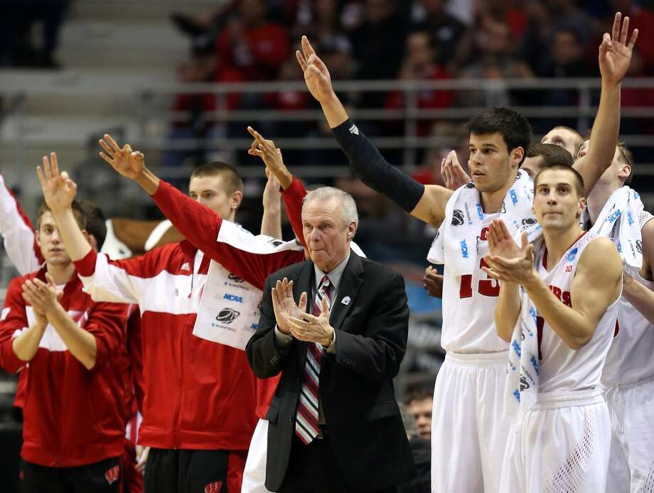 Wisconsin head coach Bo Ryan applauds from the bench alongside players during the second half. Photo: Jonathan Daniel, Getty Images