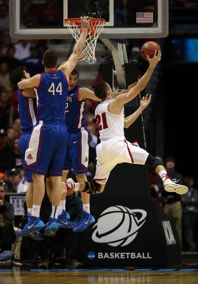 Josh Gasser shoots as Zach Elcano, Yilret Yiljep and Marko Vasic defend. Photo: Jonathan Daniel, Getty Images