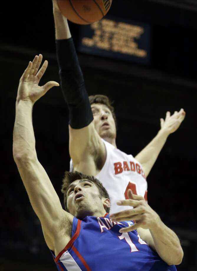 Wisconsin forward Frank Kaminsky blocks a shot by American guard Jesse Reed. Photo: Morry Gash, Associated Press