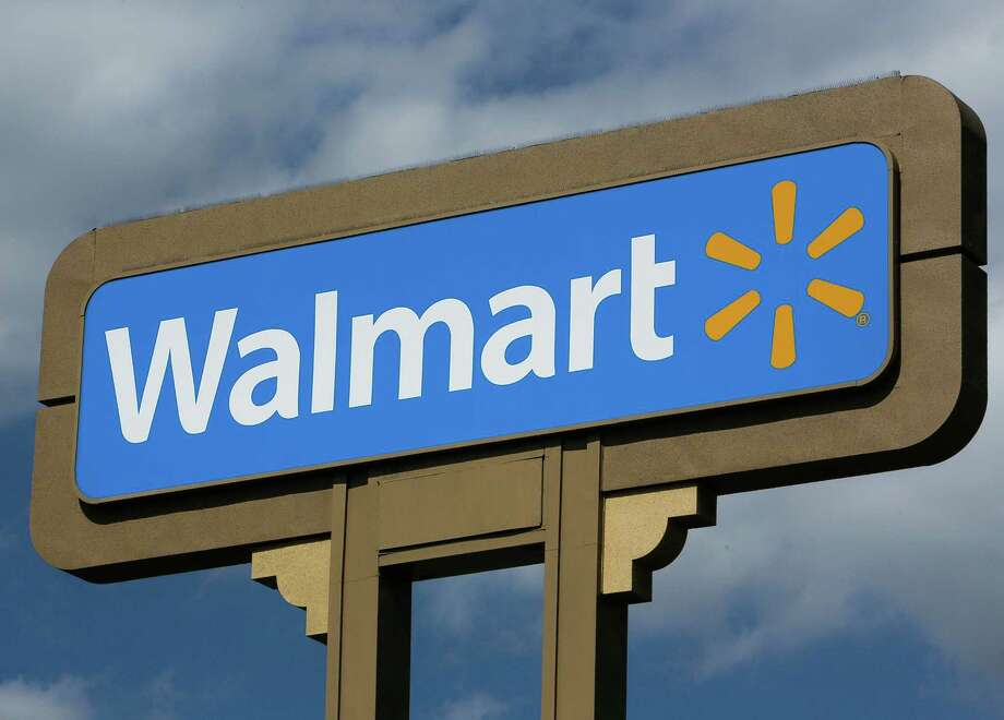 FILE - In this  May 28, 2013, file photo, an outdoors sign for Walmart is seen in Duarte, Calif. After enduring a severe winter that chilled business, Wal-Mart is trying to lure shoppers into its stores with the biggest weapon in its arsenal: a big sale. The world's largest retailer is offering up to 50 percent on more than 60 outdoor items such as lawn mowers and bags of mulch, starting Friday, March 21, 2014,  and ending the following Saturday.  (AP Photo/Damian Dovarganes) ORG XMIT: NYBZ151 Photo: Damian Dovarganes / AP