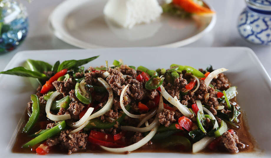 Pad gaprow, a stir-fry of basil with vegetables, offers a choice of meats. Beef seems to bring out many of the best flavors of the dish. Photo: Photos By Jerry Lara / San Antonio Express-News / © 2014 San Antonio Express-News