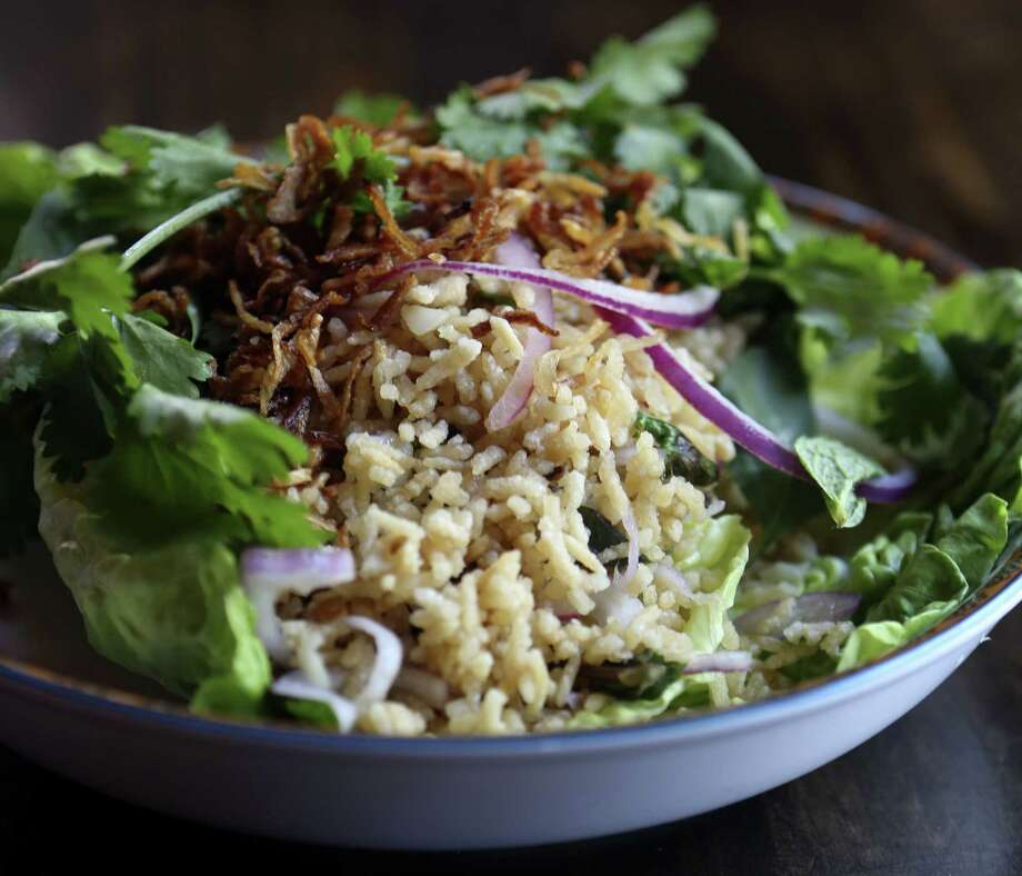 The Crispy Rice Salad at Umai Mi is a mainstay on the menu. Photo: Helen L. Montoya / San Antonio Express-News / ©2013 San Antonio Express-News