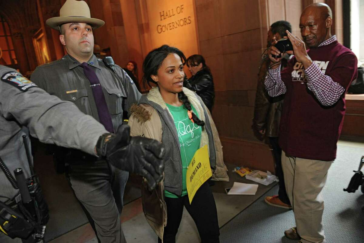 Protestors are arrested by New York State troopers during a protest at the Capitol on Thursday, March 20, 2014 in Albany, N.Y. The protestors were demanding a New York that works for all, not just the rich. (Lori Van Buren / Times Union)