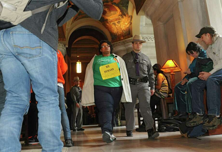 Protestors are arrested by New York State troopers during a protest at the Capitol on Thursday, March 20, 2014 in Albany, N.Y. The protestors were demanding a New York that works for all, not just the rich. (Lori Van Buren / Times Union) Photo: Lori Van Buren / 00026216A