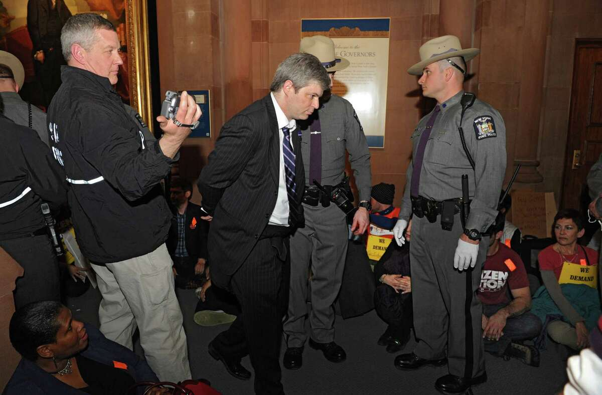 New York State troopers arrest protestors during a sit-in outside the governor's office at the Capitol on Thursday, March 20, 2014 in Albany, N.Y. The protestors were demanding a New York that works for all, not just the rich. (Lori Van Buren / Times Union)