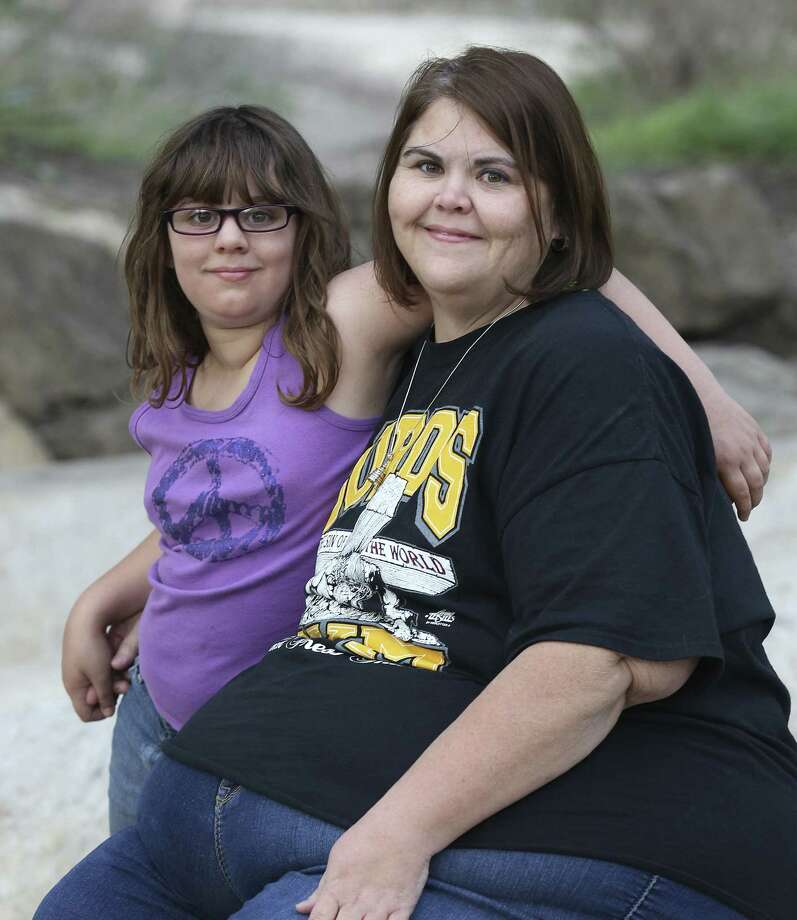 After gastric-bypass surgery, Zsalynn Whitworth, who once weighed nearly 600 pounds, has lost more than a third of her body weight. Among the benefits — enjoying activities with her daughter, Hannah Wainwright, 9. Photo: Kin Man Hui / San Antonio Express-News / ©2013 San Antonio Express-News