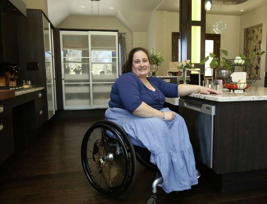 The wow factor in Vanessa Vance's kitchen begins with contemporary styling. A closer look reveals details and products that make the kitchen fully accessible for her. Photo: Photos By Helen L. Montoya / San Antonio Express-News / ©2013 San Antonio Express-News