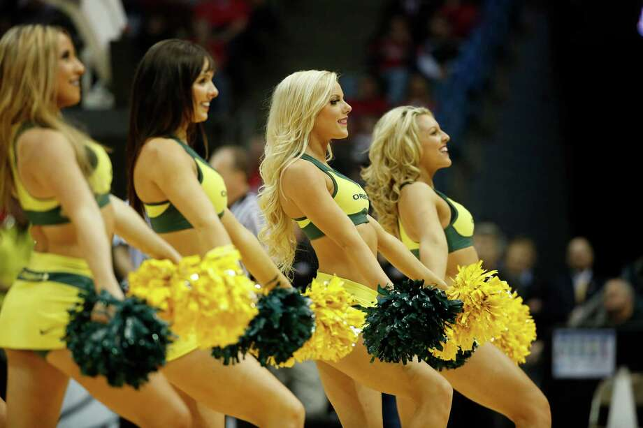 Oregon cheerleaders perform during the second half of a second-round game against the BYU in the NCAA college basketball tournament Thursday, March 20, 2014, in Milwaukee. (AP Photo/Jeffrey Phelps) Photo: Jeffrey Phelps, Associated Press / FR59249 AP